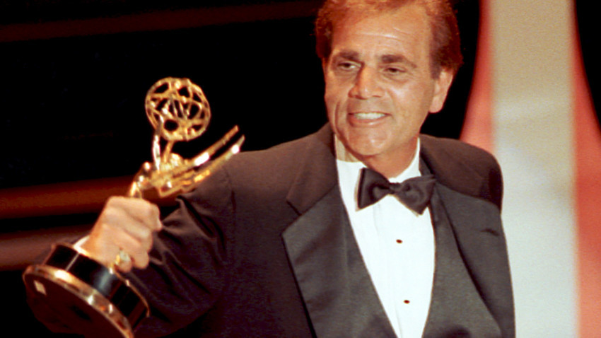 """FILE - In this Sept. 16, 1990 file photo, actor Alex Rocco holds up his Emmy award for best supporting actor in a television comedy series for his role in """"The Famous Teddy Z,"""" during his acceptance speech at the 42nd Annual Primetime Emmy Awards in Pasadena, Calif. Rocco, the character actor best known for playing the bespectacled Las Vegas mobster Moe Greene in """"The Godfather,"""" has died, his daughter announced Saturday, July 18, 2015. He was 79. (AP Photo/Nick Ut, File)"""