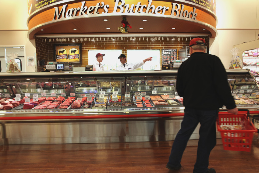 A customer eyes the meat selection at the Waltham Market Basket' (Wendy Maeda/The Boston Globe)